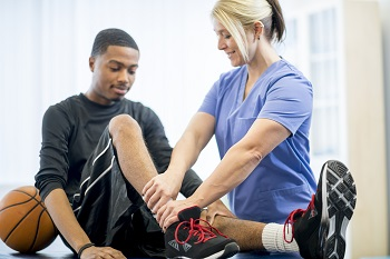 Physical therapist checking athlete