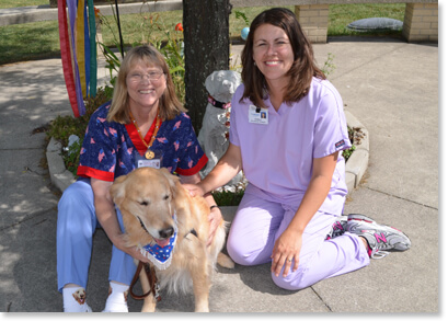 Inpatient Rehab Team staff and therapy dog
