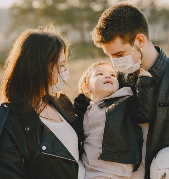 Family wearing face masks with baby during COVID-19 outbreak