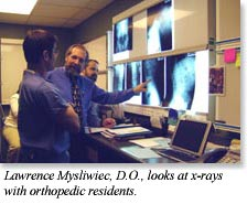 Dr. Mysliwiec looks at x-rays with orthopedic residents
