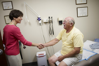 patient shaking hand with doctor