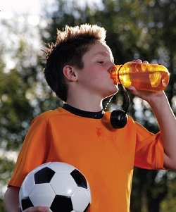 soccer boy drinking sports drink