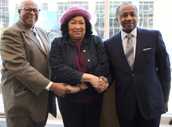 Pastor Jones, Mayor Waterman, Rev. McDonald holding hands at MLK day celebration