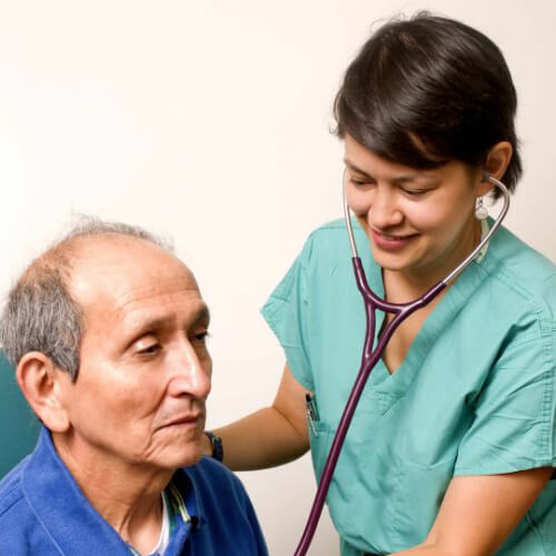 Doctor listening with stethoscope